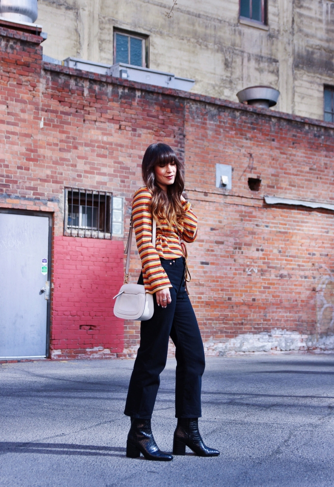 Womens fashion, retro style, striped top, wide leg jeans, bolo tie, snake print boots.